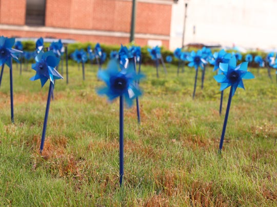 Holly Marcus / Special to The News Leader Pinwheels on the lawn of the Augusta County Courthouse on April 11 represent the 182 local children, victims of physical and sexual abuse and neglect, who are helped on average each year by the Valley Children's Advocacy Center.