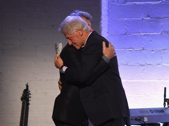 Jon Bon Jovi and Bill Clinton embrace at the Jon Bon Jovi Soul Foundation's 10 year anniversary at the Garage on October 6, 2016 in New York City.