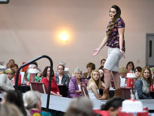Leandra Coffman walks the runway at the Matthew 25 AIDS Services 10th annual Runway Red charity fashion show held at Community Baptist Church on Saturday.