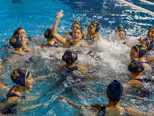 The La Quinta girls celebrate their win over Xavier