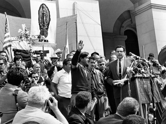 AP In this April 11, 1966, file photo, Cesar Chavez, leader of the Delano grape pickers? strike, waves to the crowd from the steps of the California Capitol in Sacramento. FILE - In this April 11, 1966, file photo, Cesar Chavez, leader of the Delano grape pickers' strike, waves to the crowd from the steps of the California Capitol in Sacramento. Chavez led his strikers and sympathizers on an over 300-mile, 25-day pilgrimage from Delano to the capitol in an attempt to meet with Gov. Brown on Easter Sunday.  California and several other states will honor Chavez by closing schools and state offices Friday, March 31, 2017, the 90th anniversary of the birth of a man who went from a grape and cotton picker to an enduring hero for laborers, Latinos and justice seekers of all kinds. Farmworkers in four states plan to march Saturday and Sunday in honor of Chavez, who died in 1993, and in protest of President Donald Trump's immigration policies. (AP Photo/File)
