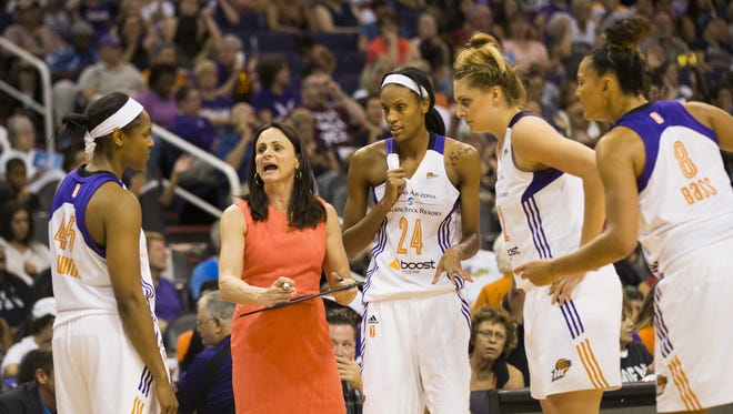 Phoenix Mercury head coach Sandy Brondello draws a play up for her team against the Indiana Fever during WNBA play at US Airways Center in Phoenix, Ariz. August 16, 2015.