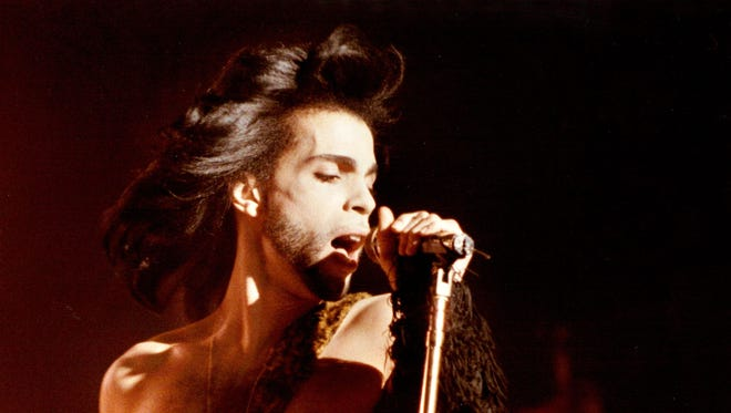 "In this May 2, 1990 photo Prince performs a benefit concert for the family of Charles (Big Chick) Huntsberry in Minneapolis. Prince, widely acclaimed as one of the most inventive and influential musicians of his era with hits including ""Little Red Corvette,"" ''Let's Go Crazy"" and ""When Doves Cry,"" was found dead at his home on Thursday, April 21, 2016 in suburban Minneapolis, according to his publicist. He was 57."