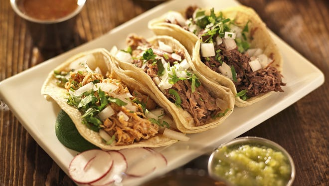 Authentic mexican barbacoa, carnitas and chicken tacos Credit: rez-art/iStockphoto, Getty Images Thinkstock GETTY ID#: tacos.JPG  [Via MerlinFTP Drop]