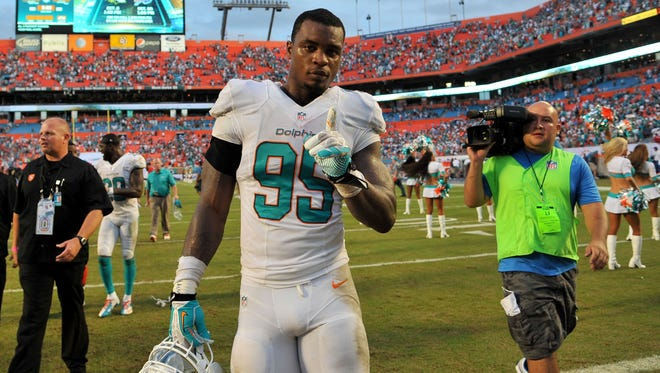 Miami Dolphins defensive end Dion Jordan is seen after the team?s game against the Atlanta Falcons last Sept. 22 in Miami Gardens.  USA TODAY Sports Sep 22, 2013; Miami Gardens, FL, USA; Miami Dolphins defensive end Dion Jordan (95) reacts after defeating the Atlanta Falcons at Sun Life Stadium. Mandatory Credit: Steve Mitchell-USA TODAY Sports