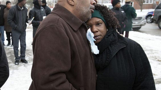 Christopher Samuel hugs his wife, Vanessa, during a neighborhood gathering for his daughter Christina Samuel at the corner of Carlisle and Redmond in Detroit on Jan 11, 2015.