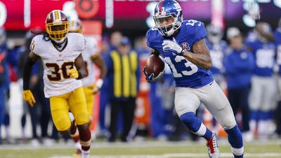 Odell Beckham Jr. runs downfield during a Dec. 14, 2014 game against the Washington Redskins in this file photo.