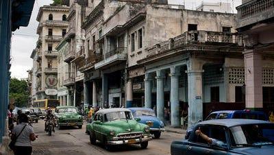 Cars drive down a street in Havana, Cuba, on Friday, June 1, 2012.