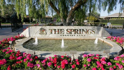 The security director at The Springs Country Club is accused of assault with a deadly weapon, investigators said.