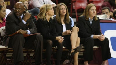 Meg Sanders, second from right in 2009 photo, is leaving after 14 seasons as ASU women's basketball associate head coach under Charli Turner Thorne. She wants to spend more time with her family.