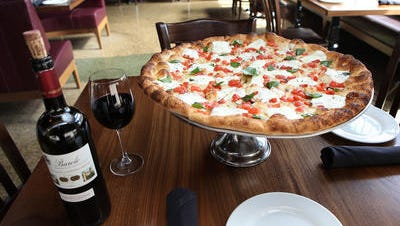 Sandra Special Pizza, (thin crust pizza with chopped plum tomatoes, garlic, basil, fresh mozzarella and a touch of olive oil) on the menu at Modern Restaurant and Lounge in New Rochelle