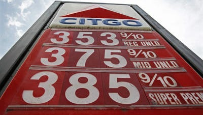 A sign advertises gas prices last spring.