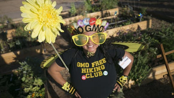 """The very notion of Michelle Obama """"partnering"""" with GMO-producing Monsanto to encourage kids to eat genetically modified foods would make this person's flower wilt"""