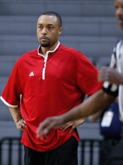 Flint Beecher head coach Mike Williams watches action against Detroit Loyola in the Class C semifinals on Thursday, March 24, 2016 at Breslin Center in East Lansing.