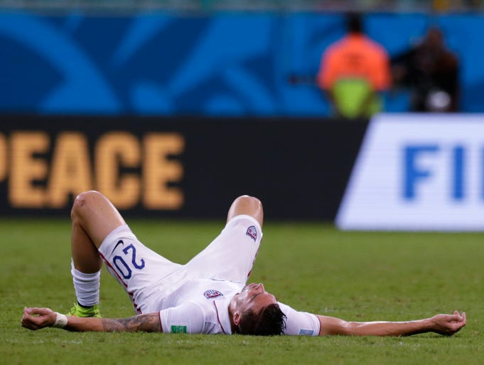 United States' Geoff Cameron lays on the pitch after the World Cup round of 16 soccer match between Belgium and the USA at the Arena Fonte Nova in Salvador, Brazil, Tuesday, July 1, 2014. Belgium won the match 2-1 after extra-time.  (AP Photo/Julio Cortez)