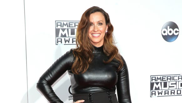 Alanis Morissette attends the 2015 American Music Awards.