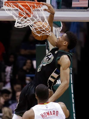 Giannis Antetokounmpo dunks against Atlanta during the Bucks' victory Saturday.