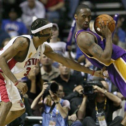 Pistons guard Richard Hamilton plays touch defense