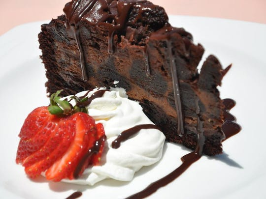 Chocolate madess, a cake full of brownie chunks, caramel, toffee chips and doused with chocolate sauce, is Chef Owen's solution to even the severest case of choc craving.