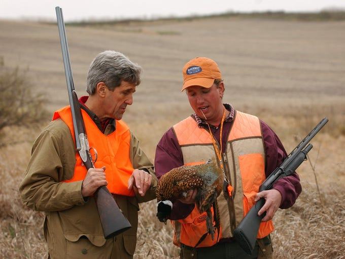 Democratic presidential hopeful John Kerry, left, inspects