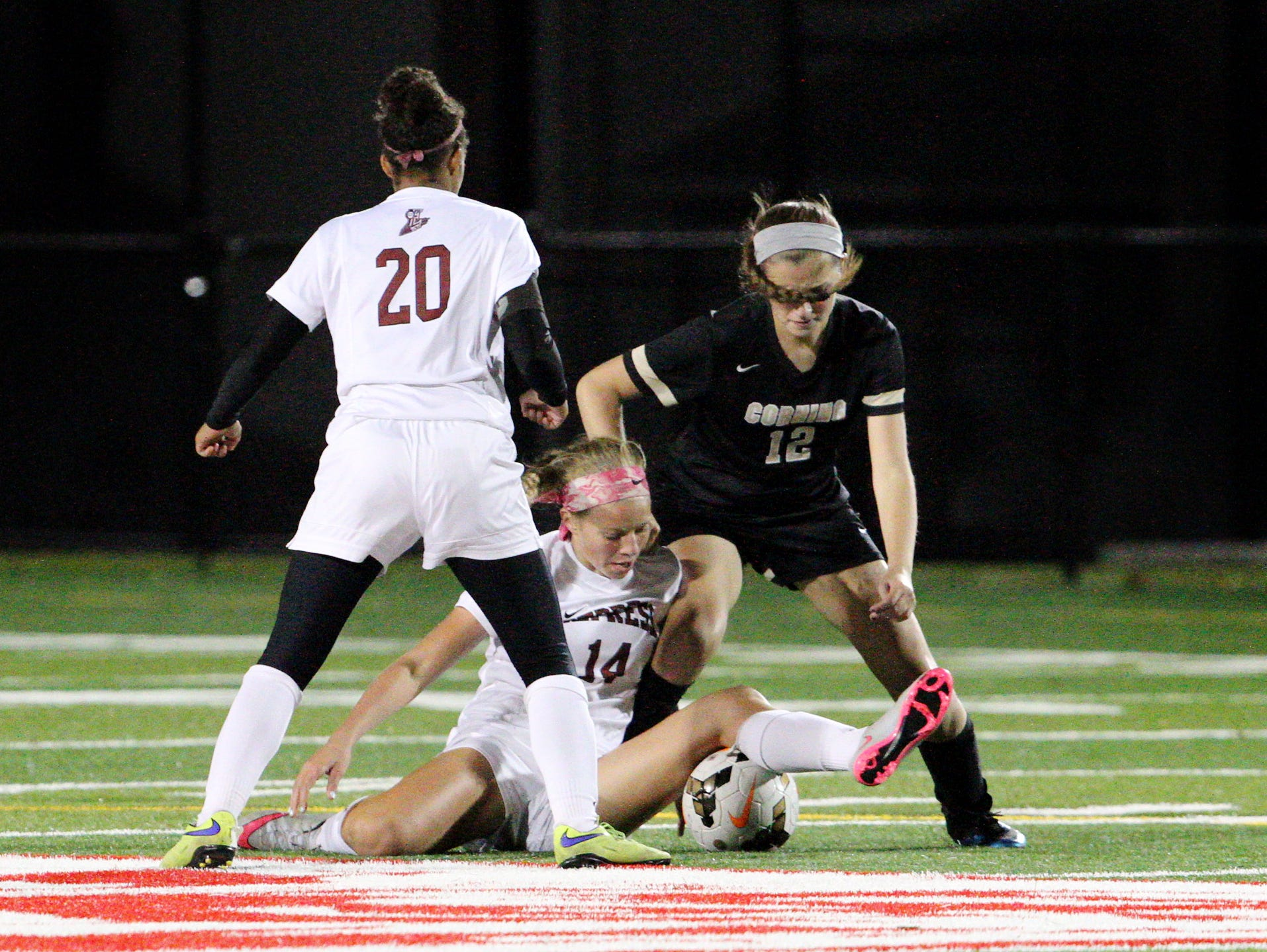 Elmira's Alexis Boorse fights over the ball with Corning-Painted Post's Liz Weinstein Friday during the Class AA Section 4 final.