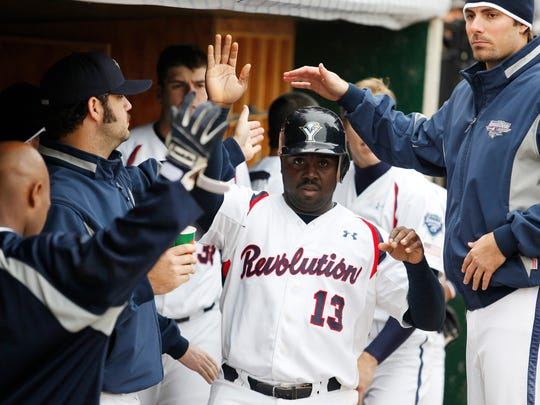 York Revolution third baseman Vince Harrison is congratulated by teammates during his final professional game in 2011.