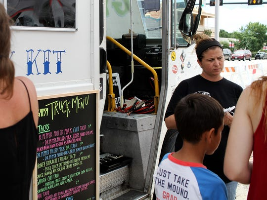 Tagan Couch of Gypsy Kit takes an order at the Food Truck Championship of Texas Saturday, June 3, 2017, in Graham. Gypsy Kit was named the Grand Champion for the second time in the three year history of the championship.
