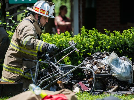 Palmyra Citizens Fire Co. Assistant Chief Justin Gernert shifts through debris as fire crews responded to a house fire at 333 Gravel Hill Road in North Londonderry Township on Saturday, July 15, 2017. Two firefighters were injured while battling the blaze and two residents were displaced.