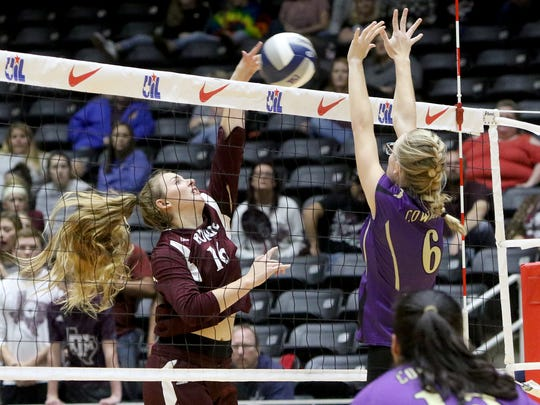 Bronte's Kristen Stilley attacks as D'Hanis' Katy Self attempts to block Wednesday, Nov. 15, 2017, in the 1A state semifinal at the Curtis Culwell Center in Garland.
