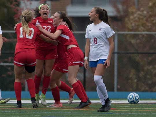 Westwood's Lucie  Gehringer celebrates with team mates