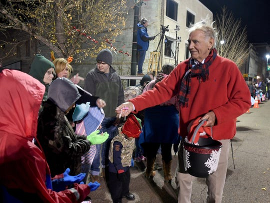 Jackson Mayor Jerry Gist hands out candy to children