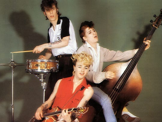Lee Rocker with fellow Stray Cats Slim Jim Phantom (top) and Brian Setzer in the early days.