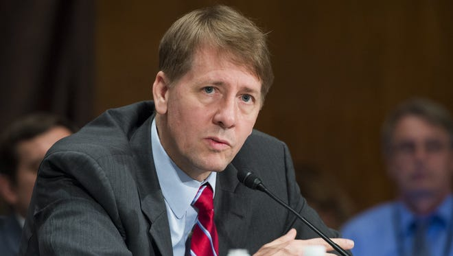 Director Richard Cordray of the Consumer Financial Protection Bureau testifies about the unauthorized opening of accounts by Wells Fargo during a Senate Banking, Housing and Urban Affairs Committee hearing on Capitol Hill.