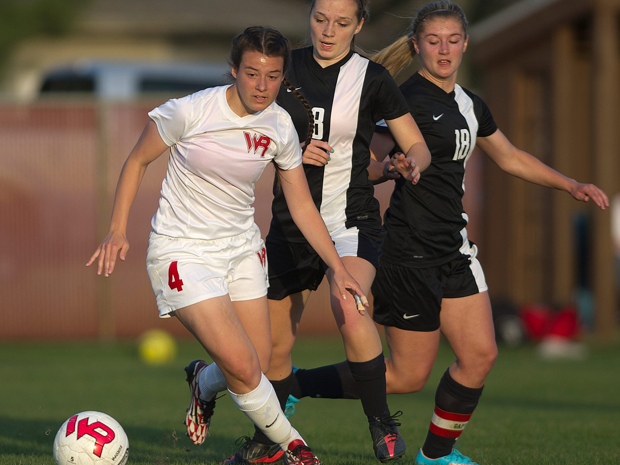 Wisconsin Rapids' Katie Kiiskila, left, moves past Stevens Point Area Senior High's Sarah Rosenthal, center, and Abby Bohanski during a Wisconsin Valley Conference soccer game Tuesday at Washington Field in Wisconsin Rapids.