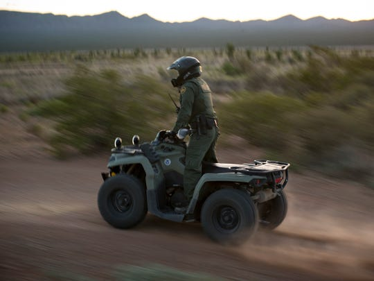 A Border Patrol agent looks for signs of human disturbance