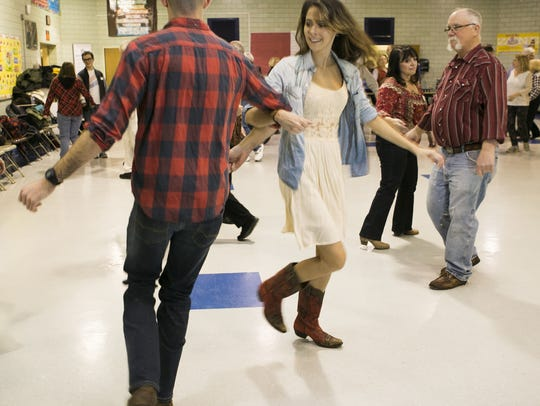D.J. Ward of Roxbury and Kristyn Scrimo of Mount Arlington, self-described enthusiasts of all-things country, try out square dancing for the first time. Reelers Square Dance Club hosts their free annual Open House for new dancers and club members at Ironia Elementary School, Randolph on Tuesday, Jan. 8, 2019.