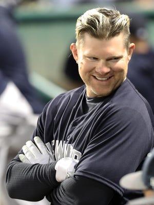 New York Yankees designated hitter Adam Lind smiles in the dugout against the Atlanta Braves at Champion Stadium.