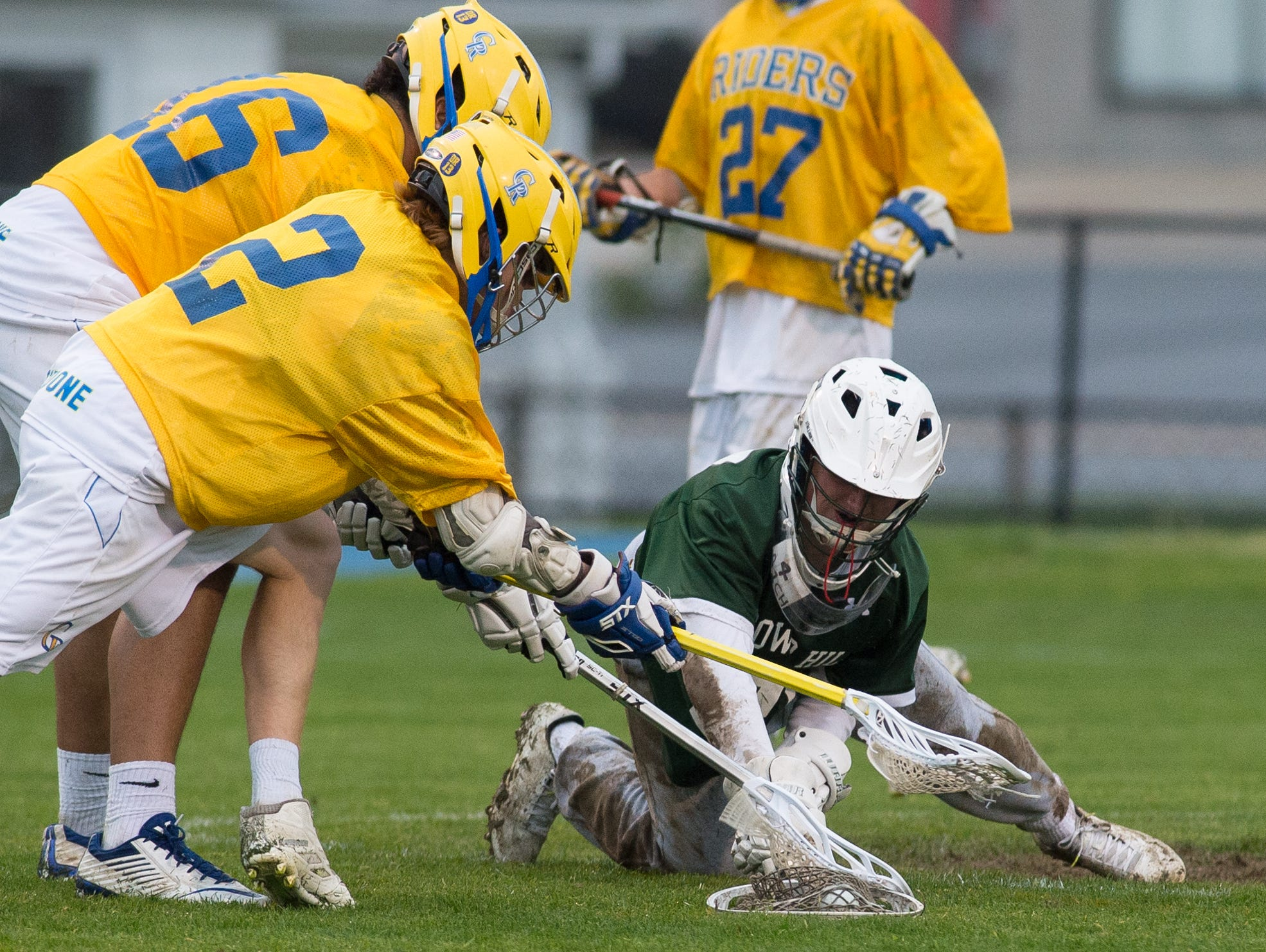Tower Hill's goalie Michael Gianforcaro (27) dives on the ball covering it in their win over Caesar Rodney.