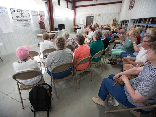 Tahn Grosse, chairman of the board of directors, speaks during the grand opening ceremony for Interfaith Food Pantry of Portage County's new location at 2810 Post Road in Plover, Tuesday,  June 21, 2016.