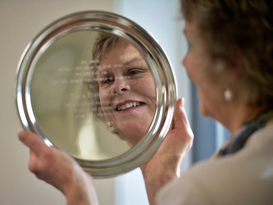 "Sunnyhill Properties, Inc., owner Tanya ""Tanny"" Nitterhouse is reflected in her award after winning Business Person of the Year at the Greater Chambersburg Chambers of Commerce annual breakfast Thursday morning, December 8, 2016 at Wilson College."