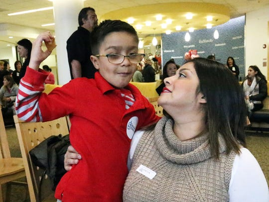 Elijah Garay, 7, a his mother, Judy Garay Tuesday at