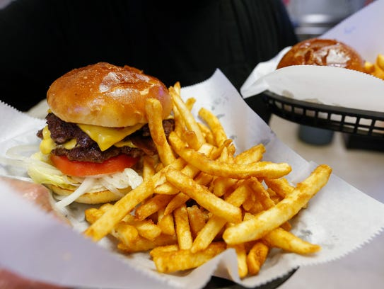 The bacon double cheeseburger and fries at Springfield