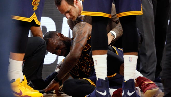 LeBron James took an elbow to the back of his neck.