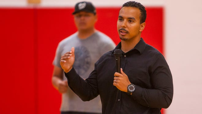 Southern Utah University head football coach Demario Warren speaks at the Paiute Tribal Center during the Paiute Restoration Gathering & Pow Wow, Saturday, June 11, 2016.
