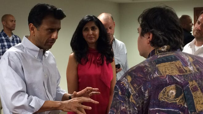 Louisiana Gov. Bobby Jindal speaks with an audience member following an event at the Coralville Public Library on Sunday.