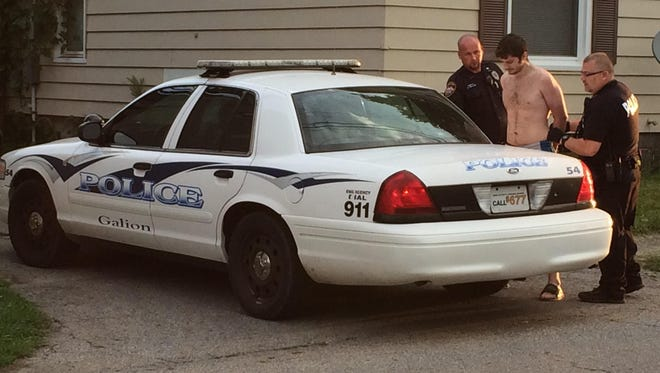 Police arrest Jesse Melba Wednesday morning after searching a home on Parson Street in Galion.