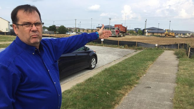 """""""We know business is business, but the real hurt is the city didn't bother to let us know,"""" said Randy Goodin, whose home shares a fence with the new Circle K."""