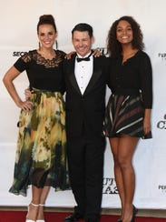 Blayne Weaver poses with Erin Cahill (left) and Lyndie