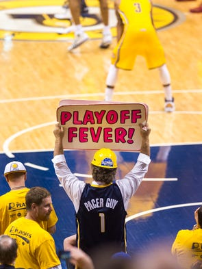 Pacer Guy, Matt Asen, helps get the crowd fired up before the first half of action. The Pacers hosted the Miami Heat in Game 1 of the NBA Eastern Conference Finals, Saturday, May 18, 2014, at Bankers Life Fieldhouse.