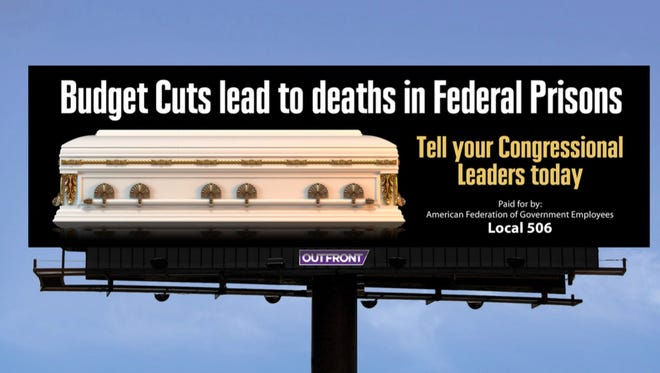 Rendering of a proposed billboard by prison union officials in an effort to call attention to dramatic cuts, warning that staffers could die if authorities proceed with a plan to eliminate more than 6,000 positions.